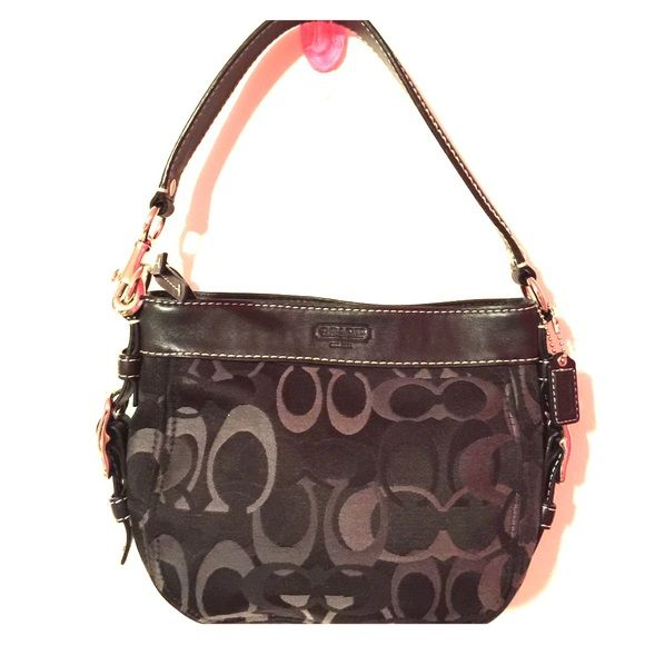 Purse Black and grey coach purse. Has small scuff on upper part of purse and pink lipstick stain inside. Is not sticky or smelly from lipstick. Coach Bags Mini Bags
