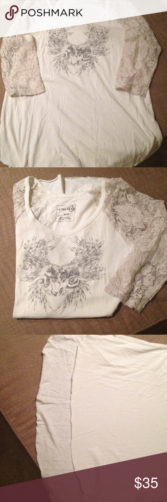 FREE PEOPLE IVORY TEE W/Animal Head, Lace SZ M Lace 3/4 sleeves, curved unfinished hem, longer in back, 100% cotton, black sketched head, worn once Free People Tops Tees - Long Sleeve