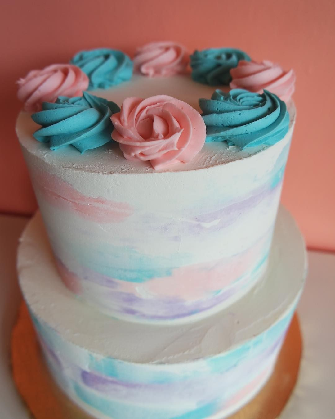Pastel Pink Blue And Purple Buttercream Watercolor Cake By