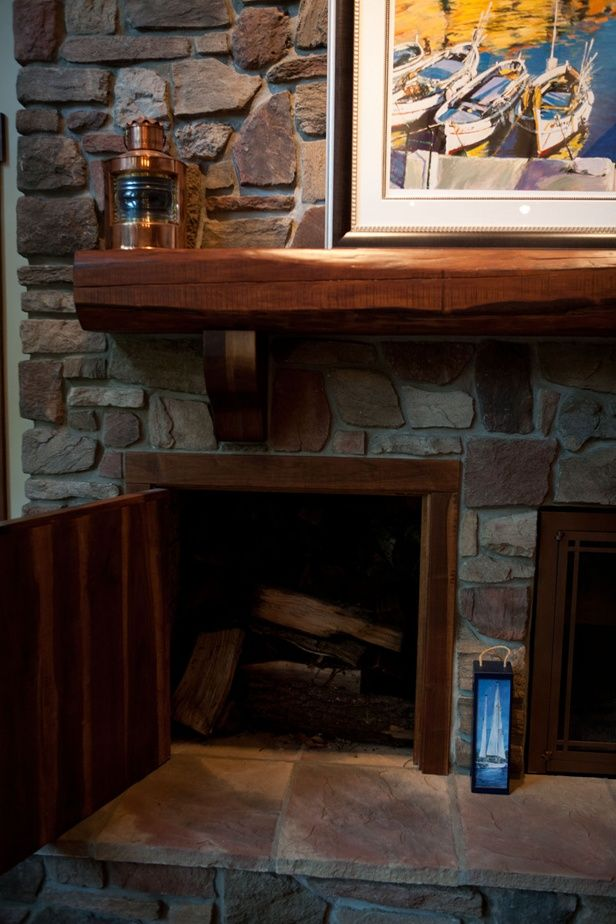 next to the fireplace a pass through storage area from the