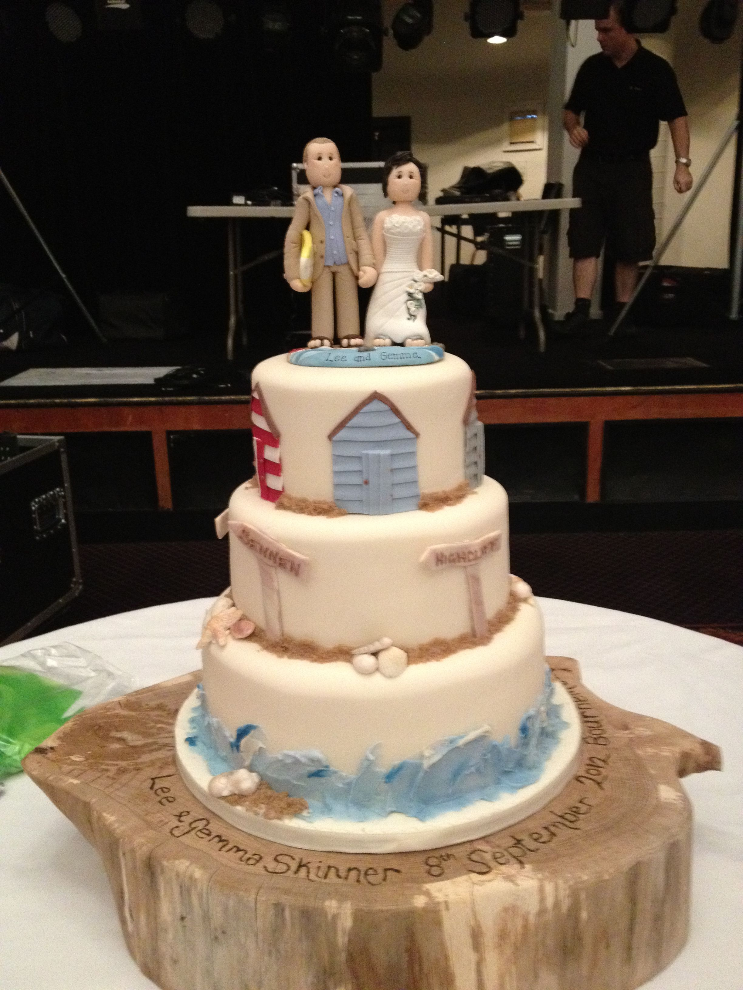 Beach Themed Wedding Cake With Unique Miniatures Of The Bride And