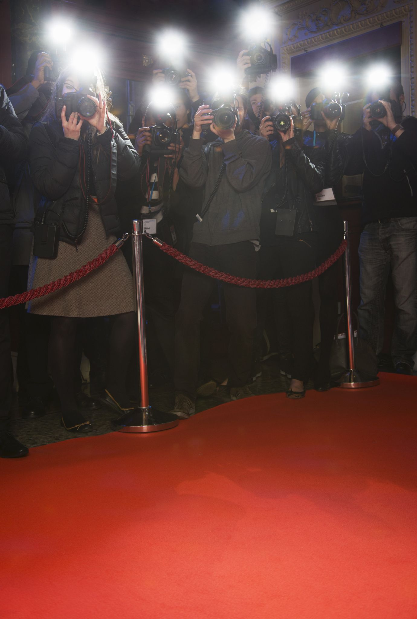 Paparazzi Using Flash Photography At Red Carpet Event By