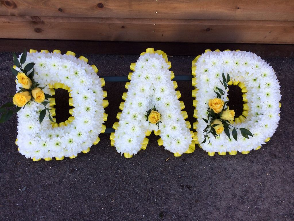 A Dad Tribute Edged With Yellow Ribbon And With Yellow Rose Sprays