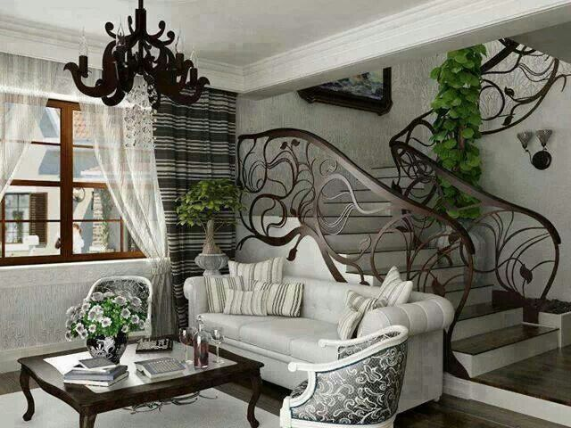 This Room Shows The Art Nouveau Style Of Interior Design Uniquely Shaped Stair Rails Chandelier And Unusual Pillar Surrounded By Decorative Vines
