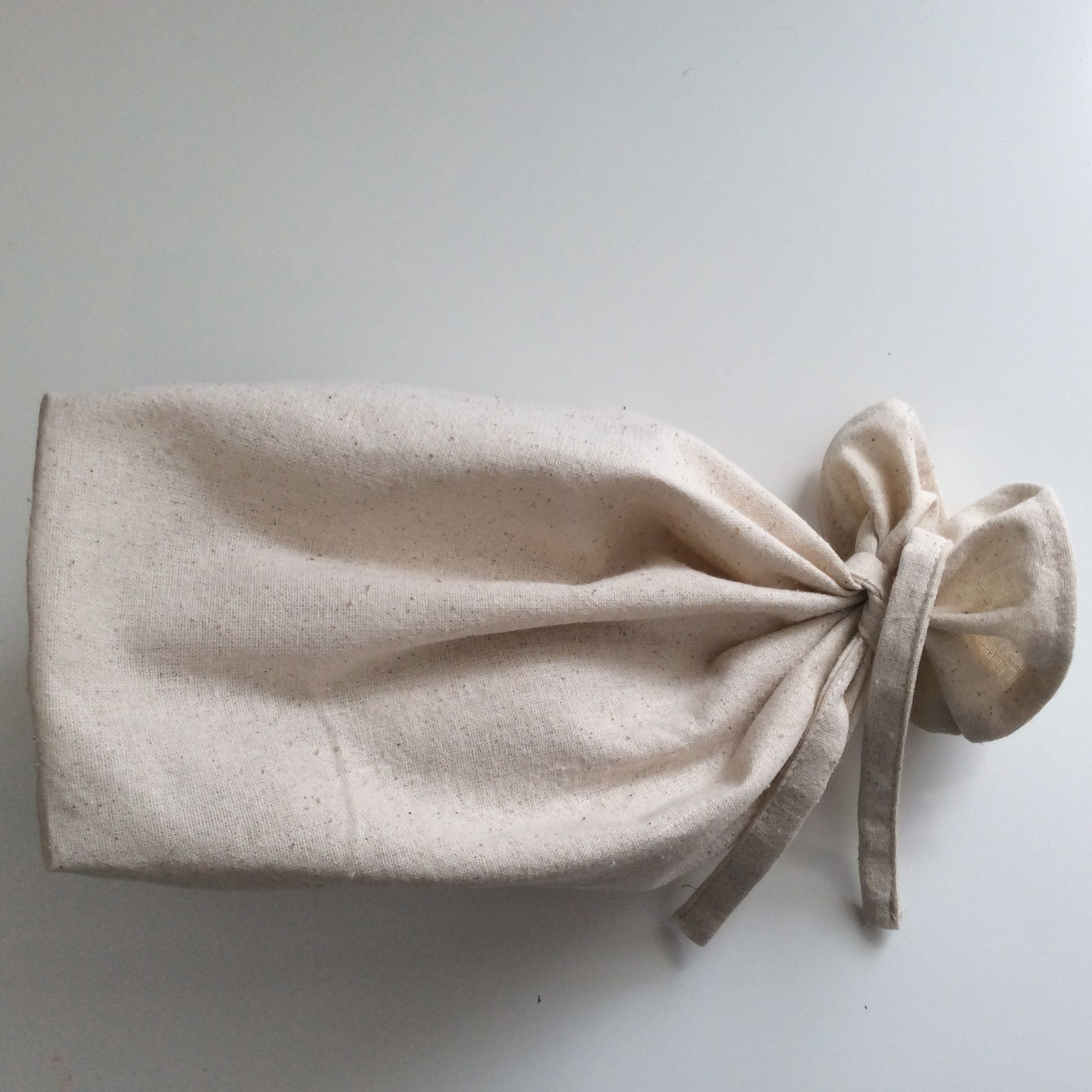 100% unbleached cotton bread bag. Available in various sizes.  https://www.etsy.com/ca/your/shops/scraphilldesigns