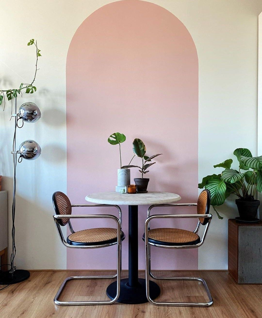 If you're feeling more ambitious, you could use paint to create an accent wall — whether you paint one wall a different color or use painter's tape or stencils to create patterns and shapes.