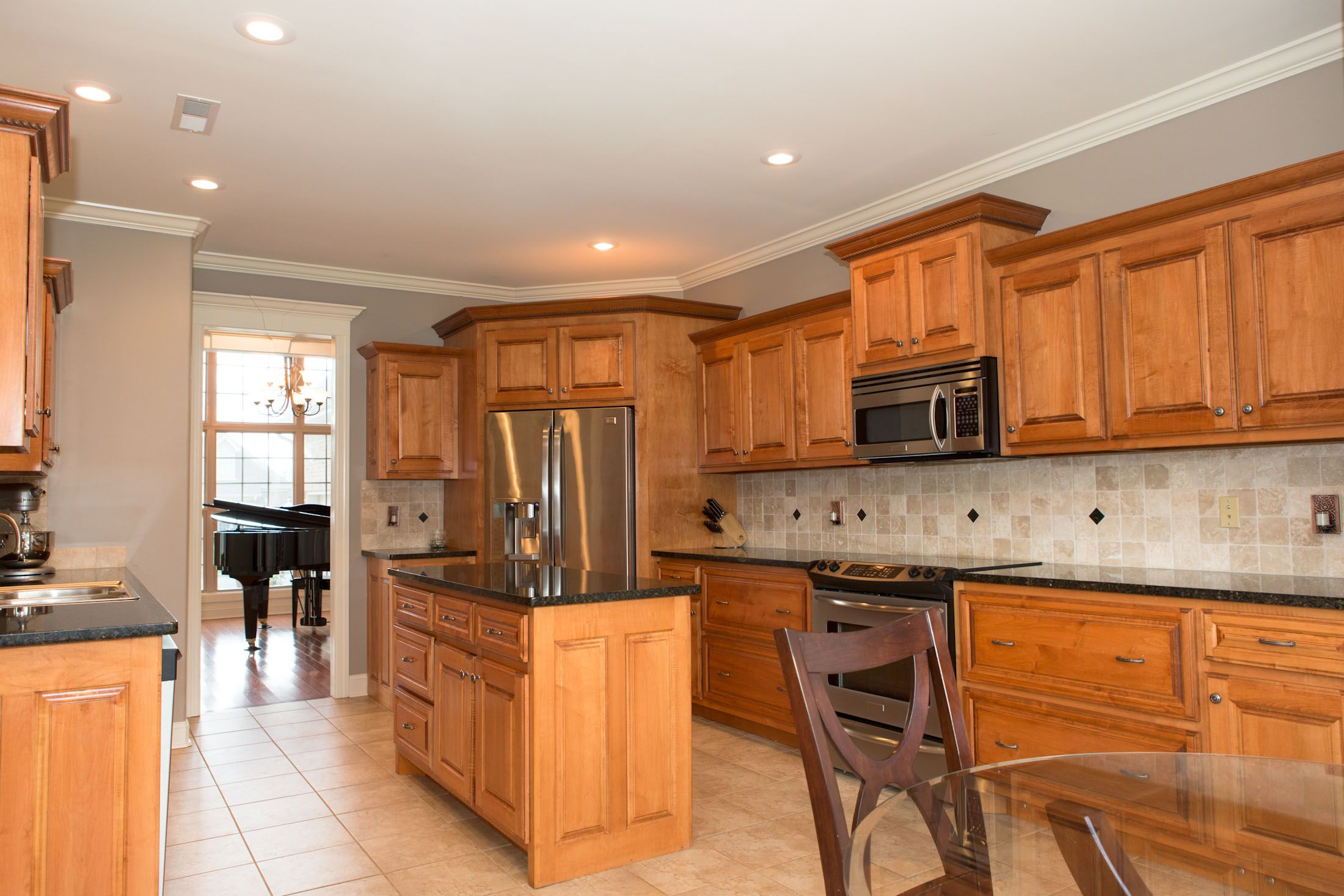 Kitchen w/ Maple Cabinets with Cherry Stain and Mocha ... on What Color Granite Goes With Honey Maple Cabinets  id=59585