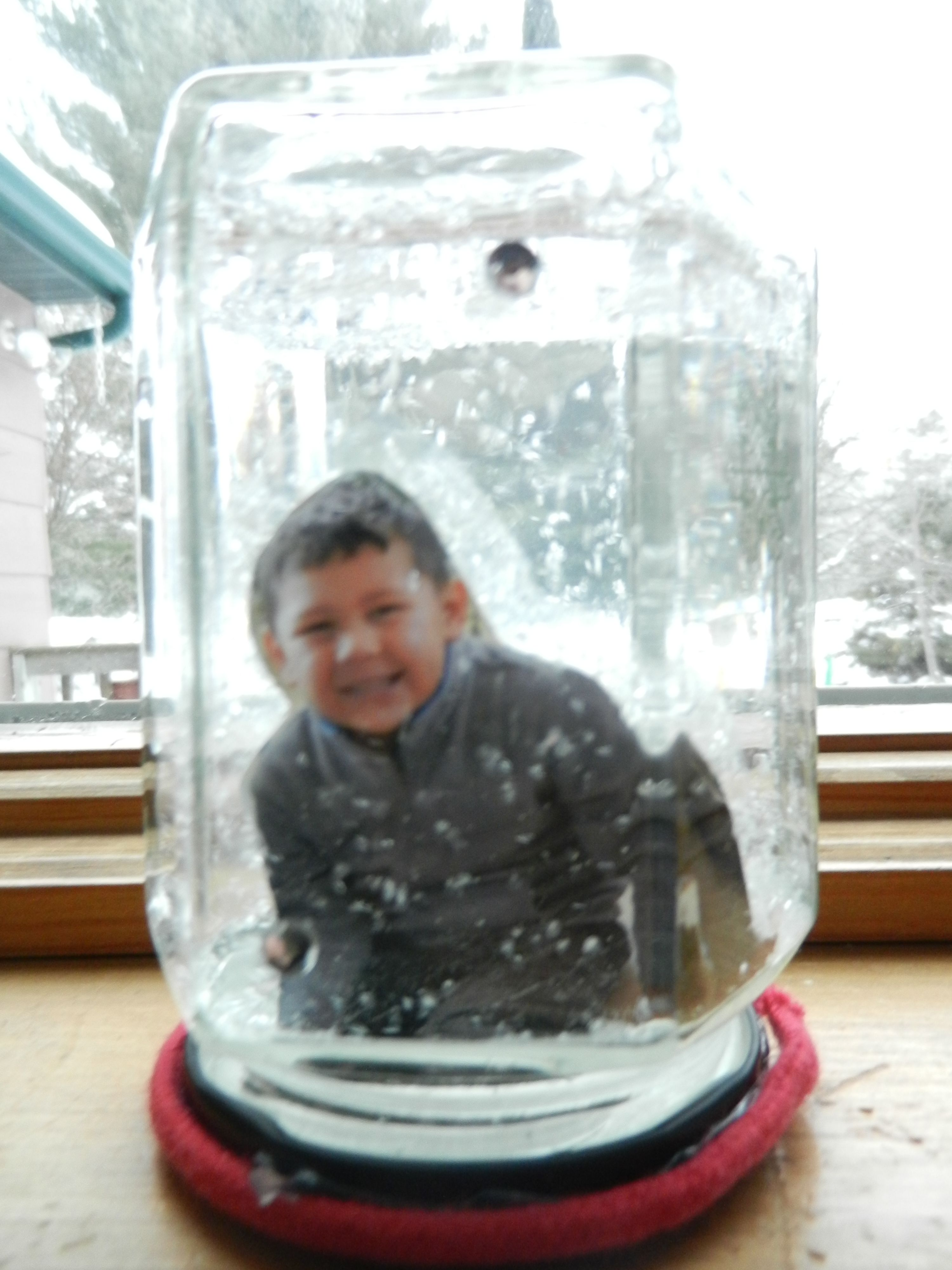 "Monster in a jar!  Create your own snow globe featuring your ""monster"" in a jar."