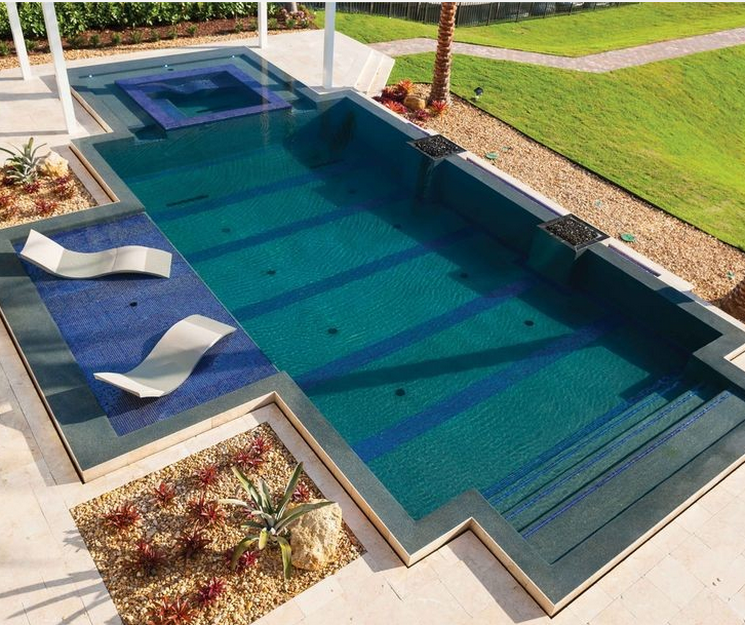 Pool With Shallow Lounge Chairs Submersed In Water