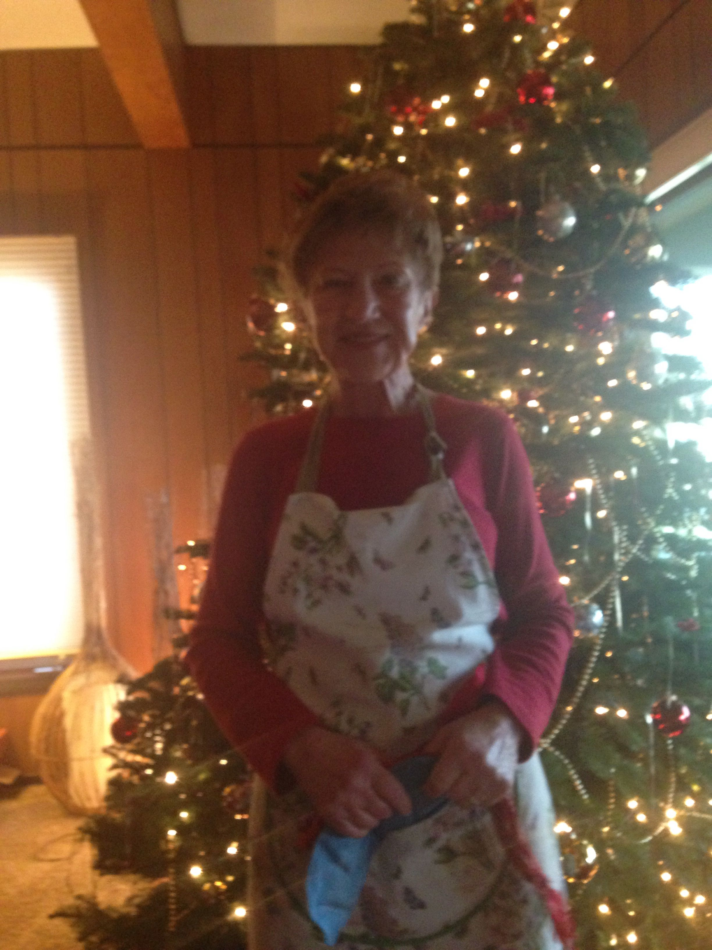 My grandmother in front of the Christmas tree