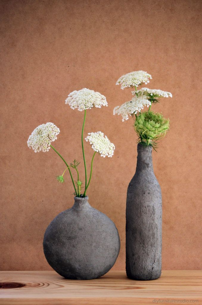 DIY cement coverend vase from hobby lobby and empty wine Supplies:  glass vase or bottle measuring cups (1/4 cup and 1 cup) dust mask protective gloves (tight-fitting) mixing bowl Quikcrete anchoring cement waterbottle