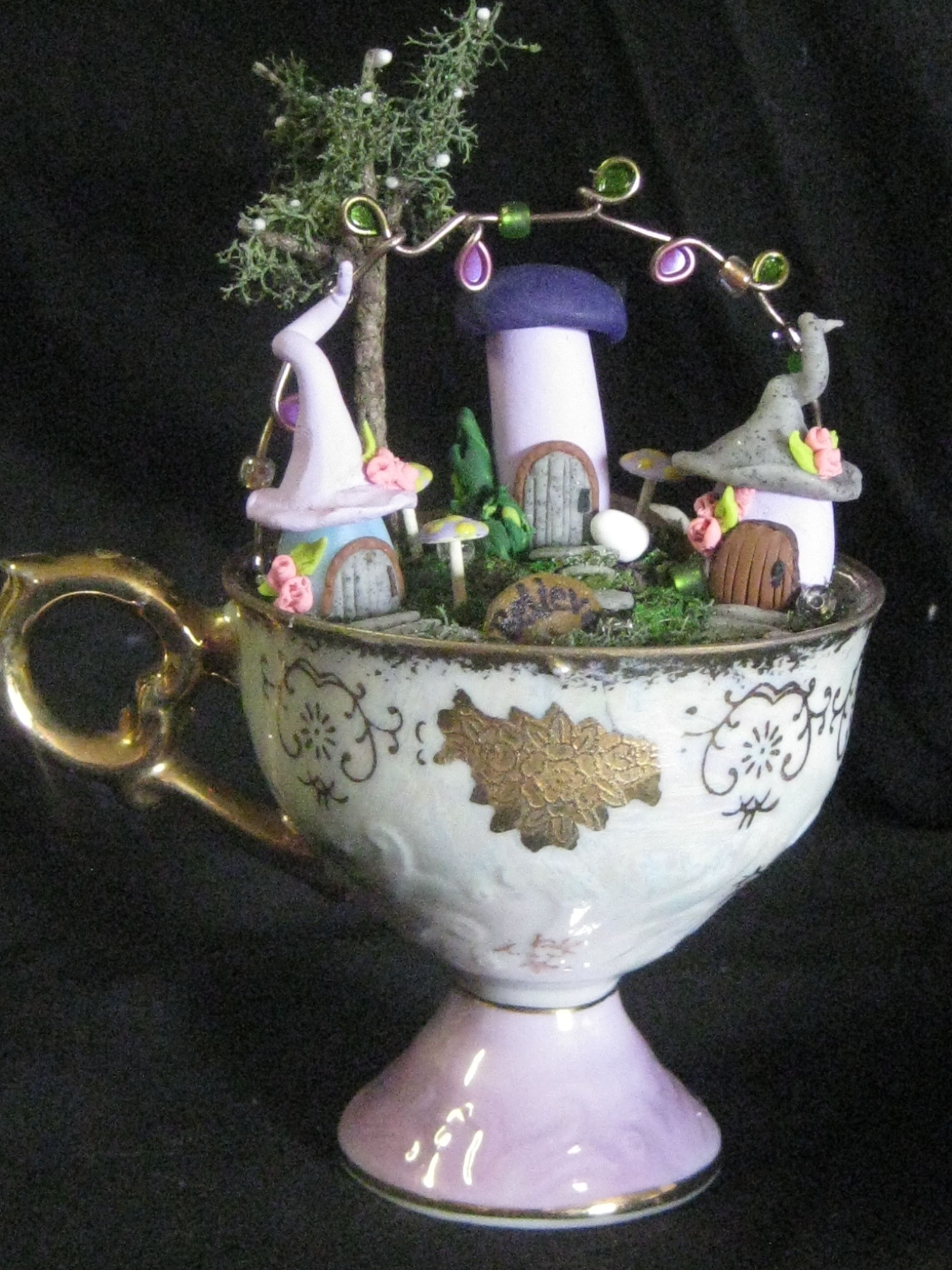 Teacup Fairy Villages By Geri Luciano Created Using Thrift Store Teacups Polymer Clay Houses Painted Furnit Teacup Crafts Fairy Village Polymer Clay Fairy