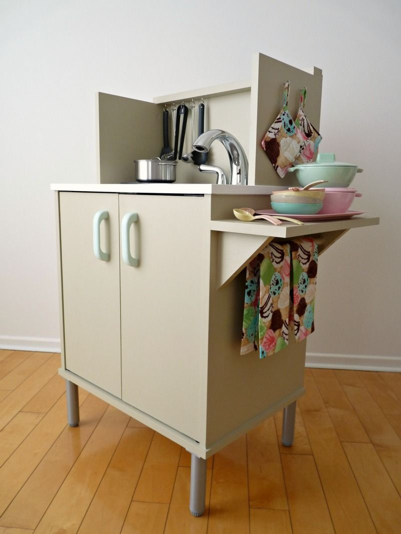 Tv cabinet converted to a kids play kitchen