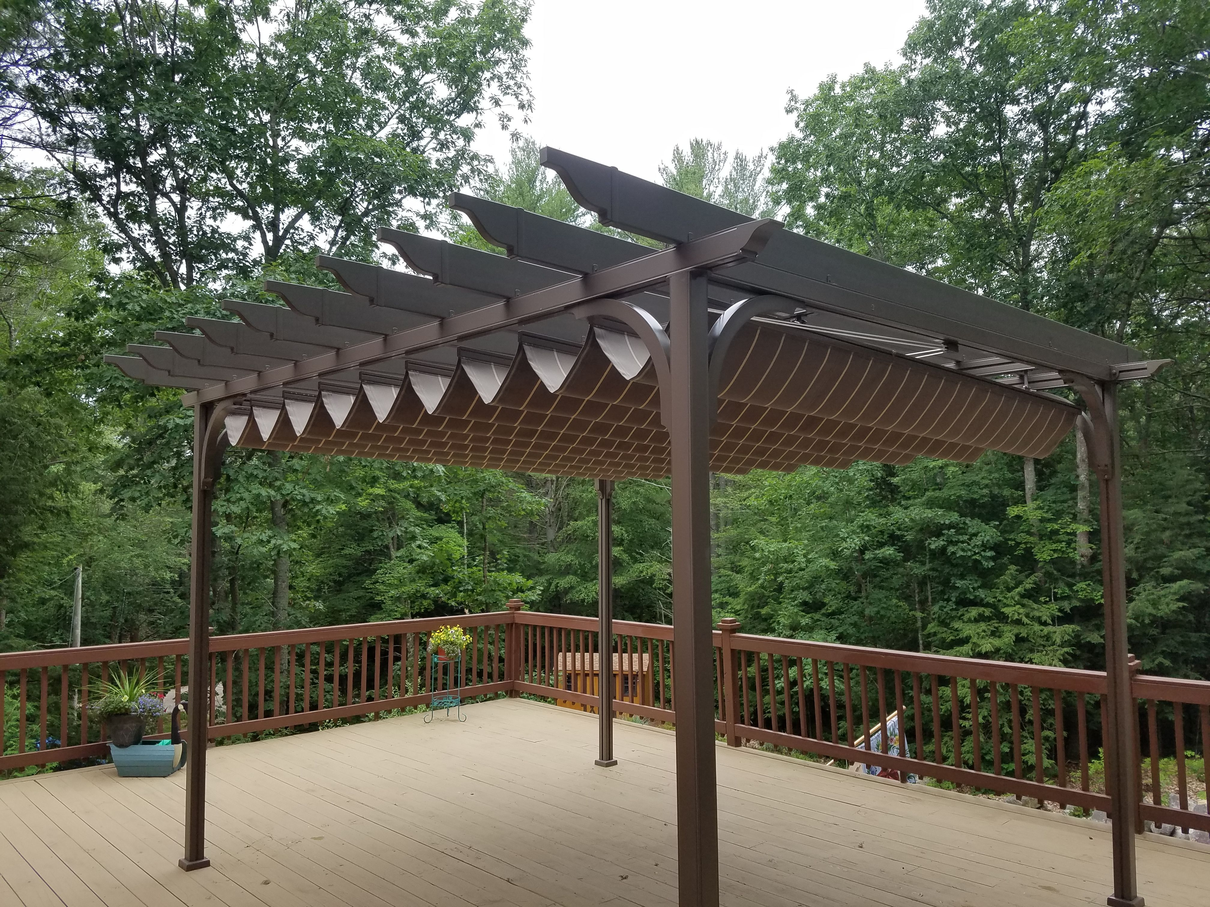 Under pergola canopy installed by betterliving sunrooms of new