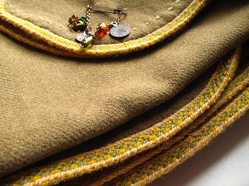 Mantle with tablet weaved border by Freddy65, via Flickr