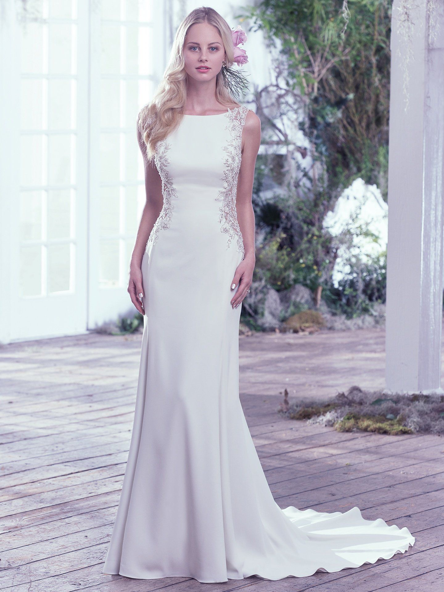 2843e21c61 A dramatic scoop back is accented with an illusion closure creating a sexy  keyhole below the natural waist. Artfully placed lace embellishments  featuring ...
