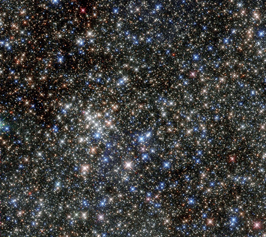 A cluster of what appears to be hundreds of stars on a black background