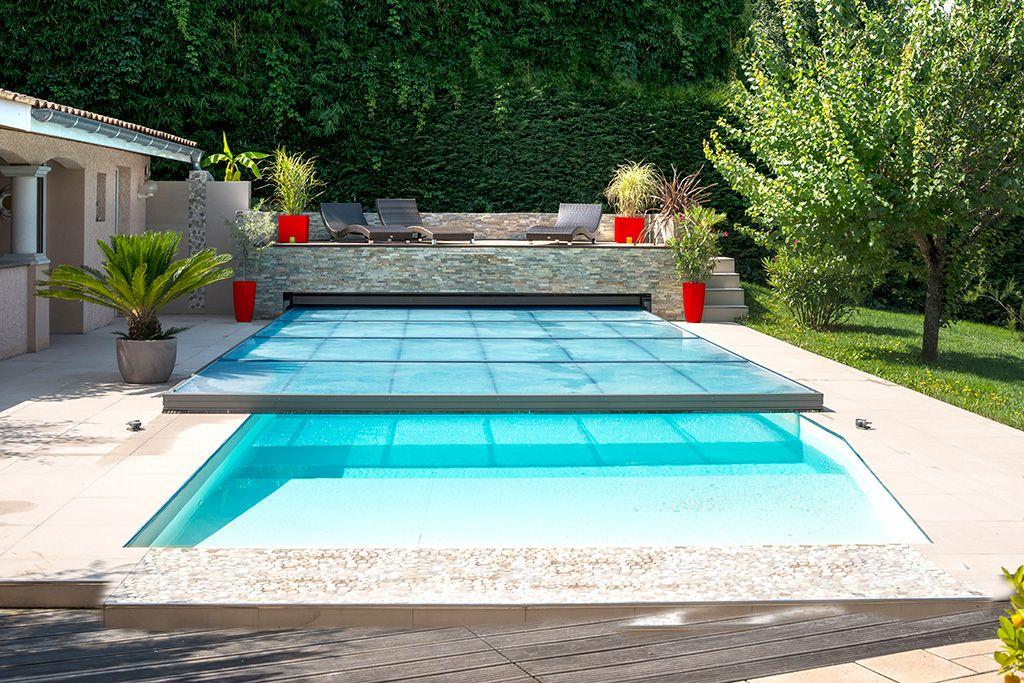 Abri piscine plat motoris solutions discr tion for Deco tour de piscine