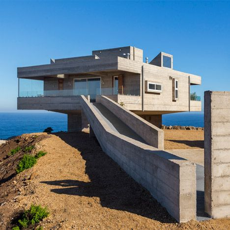 Influenced by Le Corbusier's Villa Savoye, this concrete residence by Gubbins Arquitectos perches on the craggy cliffs of the Chilean coastline