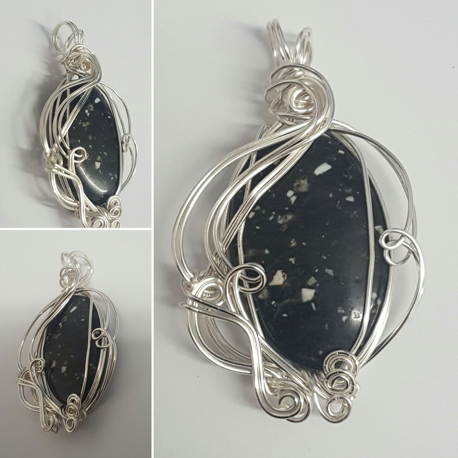 starlight quartz cabochon set in layers of swirling silver plated wire in this lovely feature pendant by YouNiqueYou on Etsy