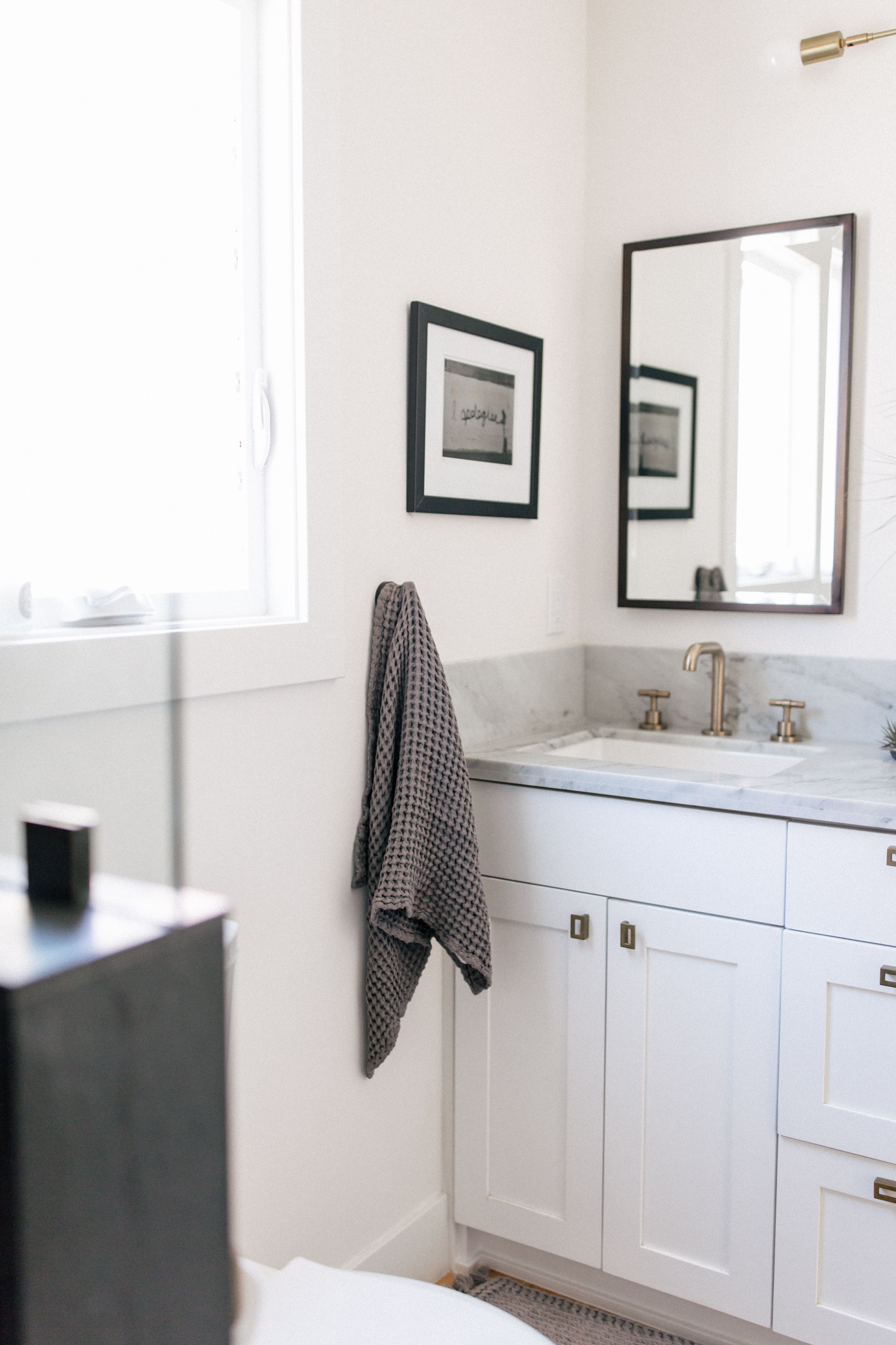 Light Grey And White Marble Contrast With The Black Mirror And
