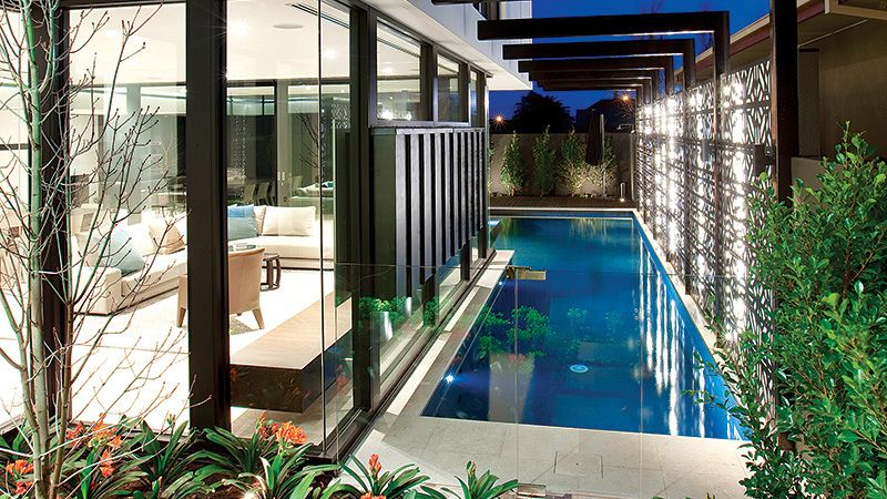 Lap pool in narrow space beside a house pinned to pool for Lap pool designs for home