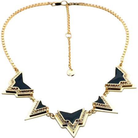 Showcasing black geometric accents surrounded by shimmering rhinestones, this fashion-forward necklace offers glamorous appeal with an edgy twist.