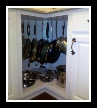 hanging pots and pans corner cabinet might do this instead of fixing lazy susan