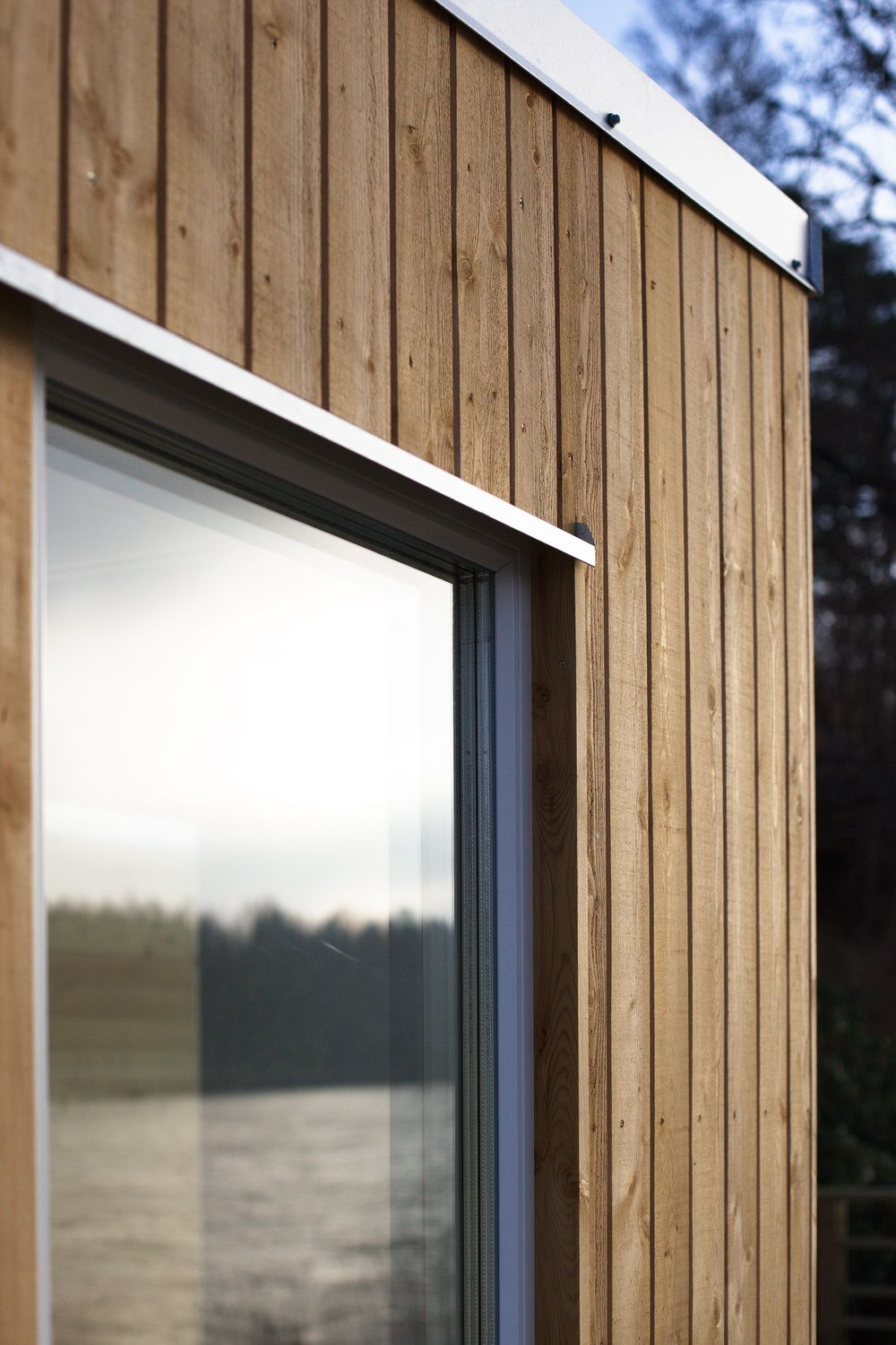 Enkelrum larch clad detail wood pinterest timber for Window cladding
