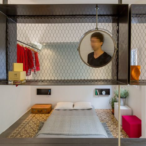 Spanish architects Nook have renovated a small apartment in Barcelona's gothic quarter, leaving decorative floor tiles in place to reveal the original layout of the flat