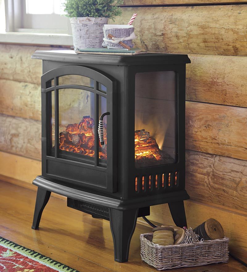 Instant Ambience Cozy Up With These Electric Fireplaces Stove Heater Electric Stove Heaters Electric Fireplace Heater