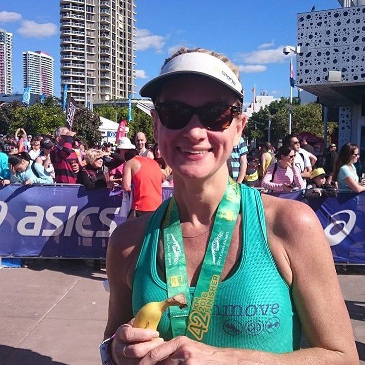 Determined as hell and pretty as a peach! Thanks @loveface_lives for the awesome pic of Carolyn and her banana at the finish line #gcam16
