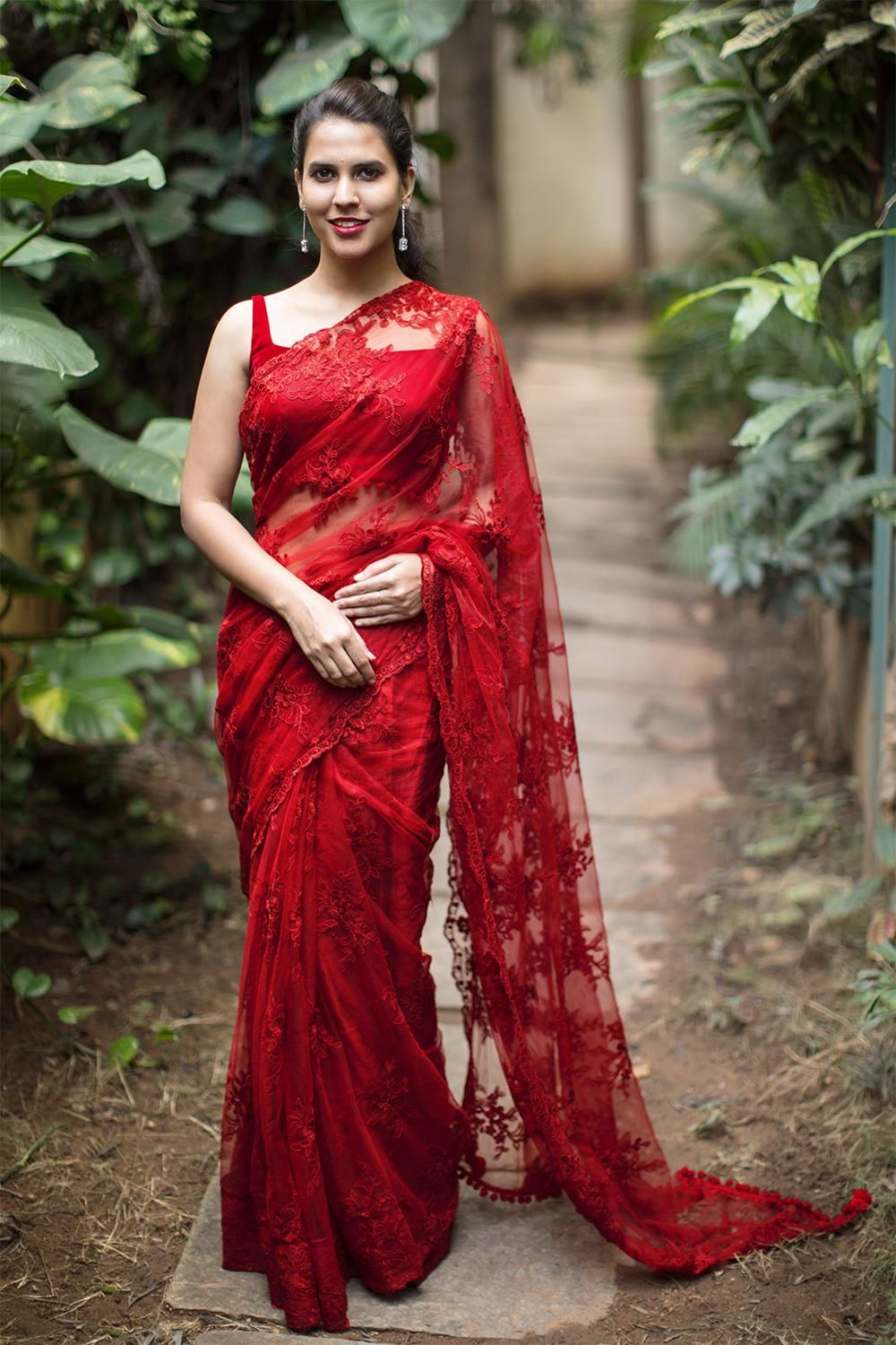 Red net with lacy self threadwork saree saree