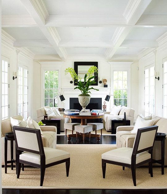 Symmetrical seating draws guests into this lavish living space  Traditional Home