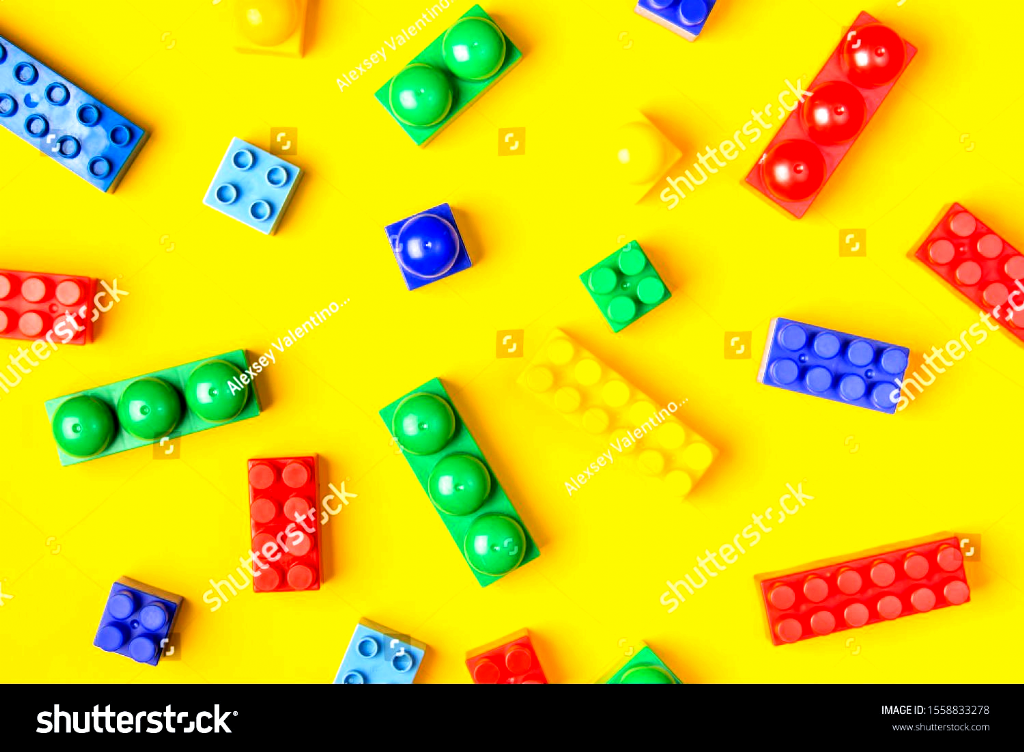 Childrens colorful background. Details of a toy constructor on a yellow background, top view. Creative and educational concept. #Ad , #spon, #Details#toy#constructor#Children