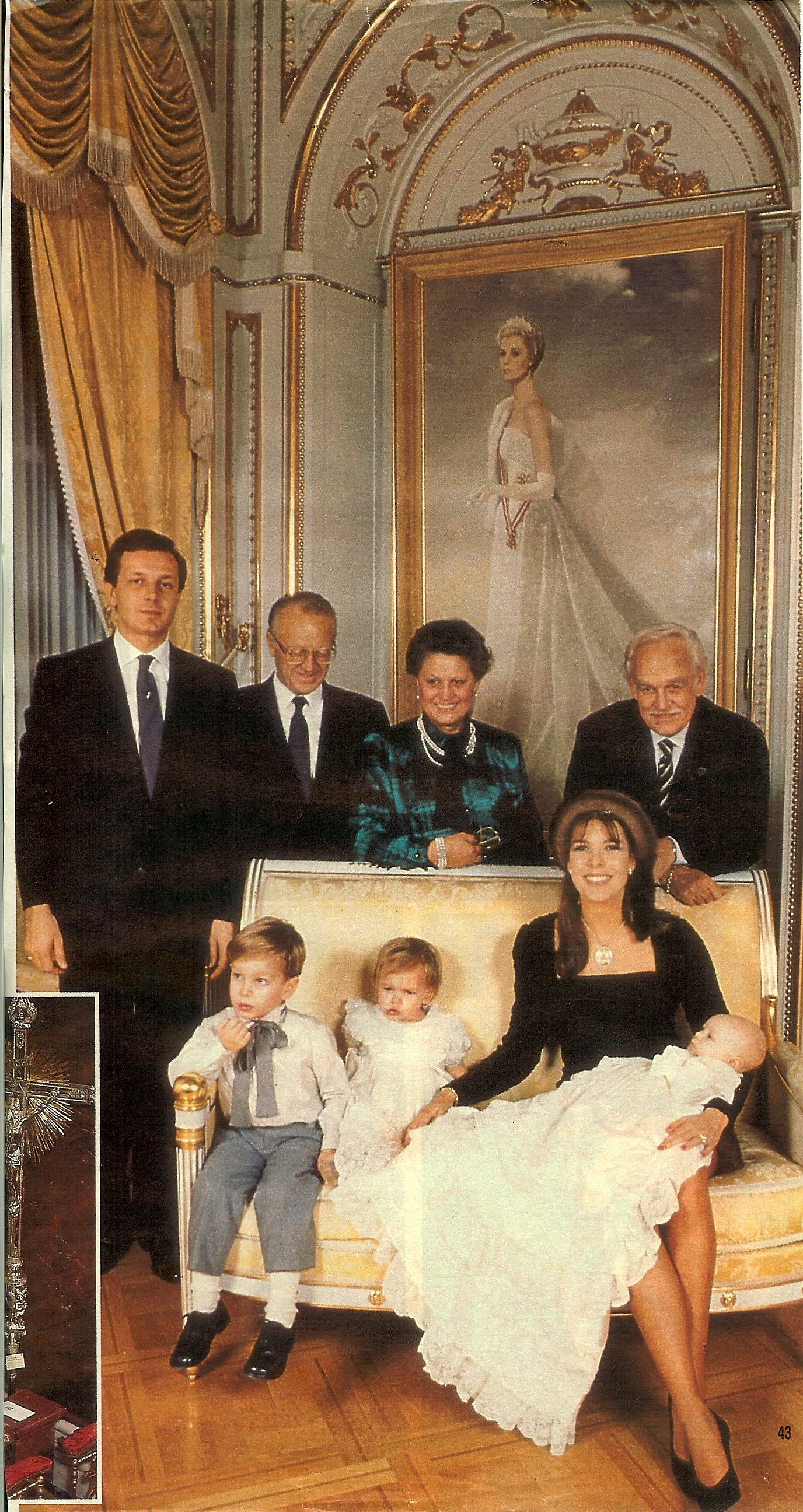 royal family of Monaco standing in front of a portrait of