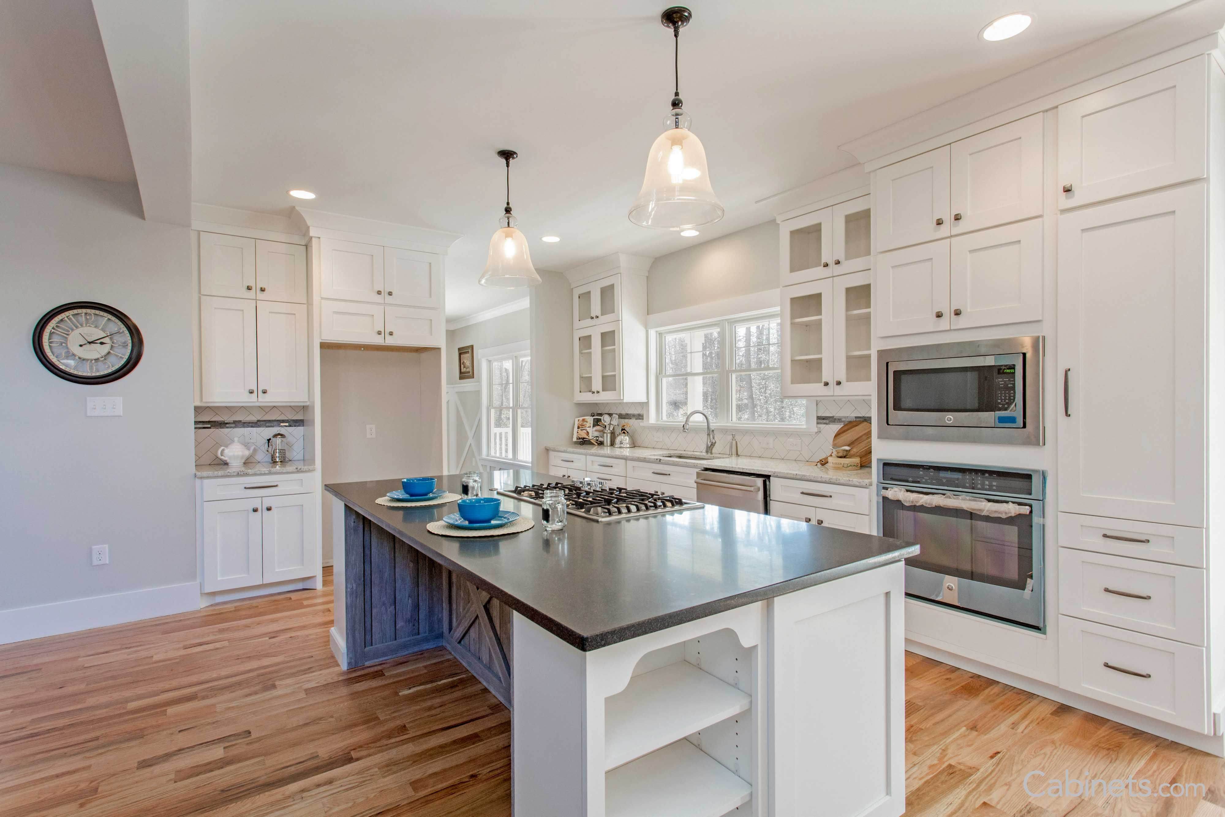 An Open Floor Plan Kitchen With Shaker Style Cabinets Built In Appliances And Bookcase Cabinets On The Farmhouse Kitchen Dream Pantry Open Floor Plan Kitchen