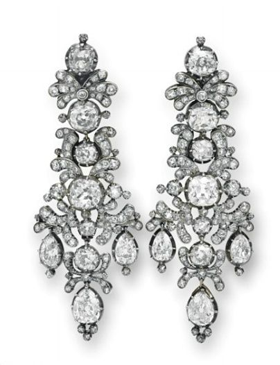 A PAIR OF ANTIQUE DIAMOND EAR PENDANTS Each designed as an old mine-cut diamond scrolling plaque, interspersed with larger bezel-set old mine cut diamonds, suspending three articulated pear-shaped old mine-cut diamonds, mounted in silver and gold, circa 1806.
