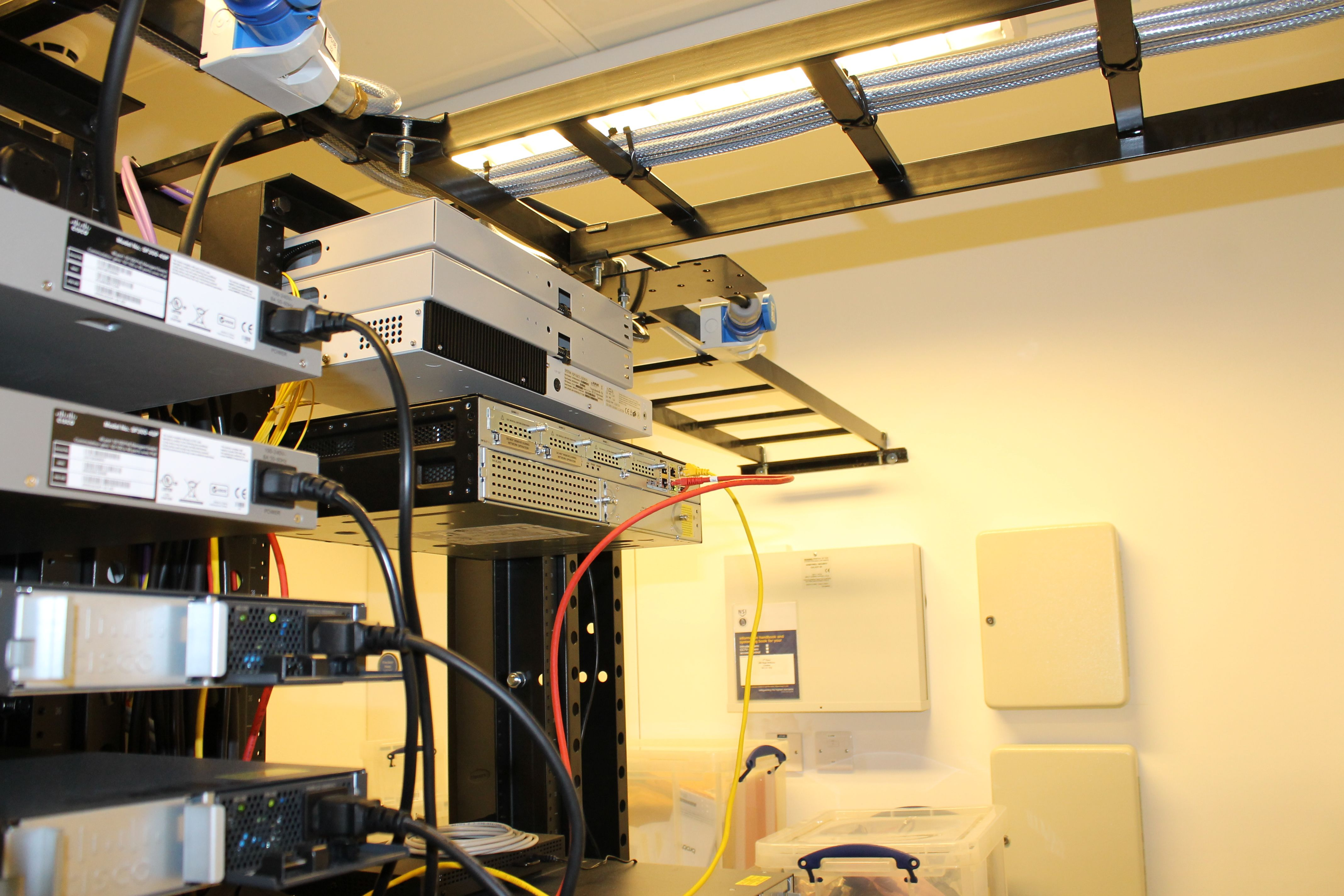 Hubbell Nextframe Overhead Ladder Rack Installation By Inflectiontech Helps Keep Cabling Oraganised Overhead Ladder Ladder Rack Data Center