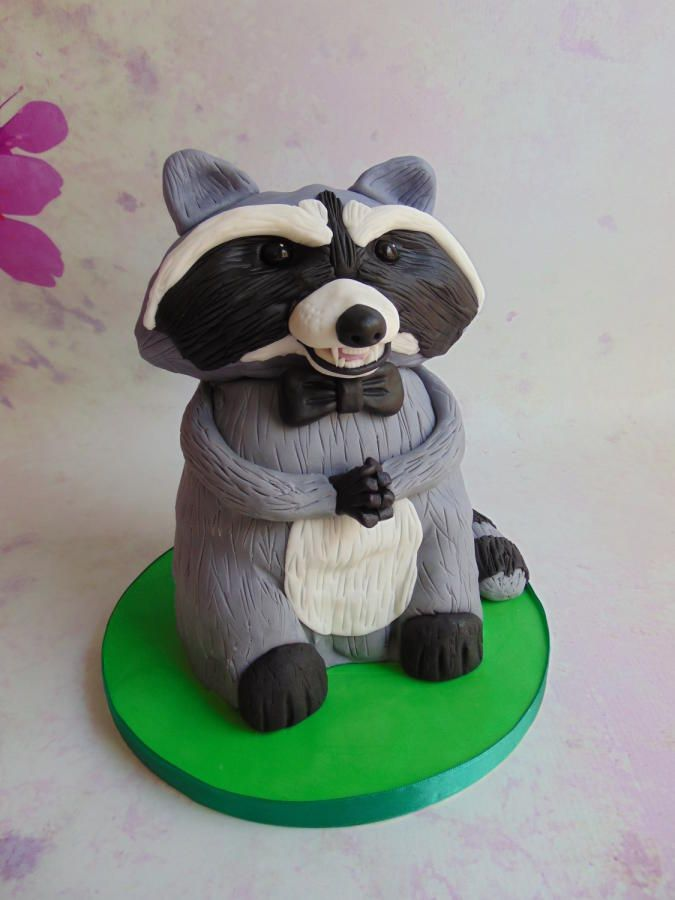 Evil Raccoon with a bow tie For the love of cake (Laylah Moore)