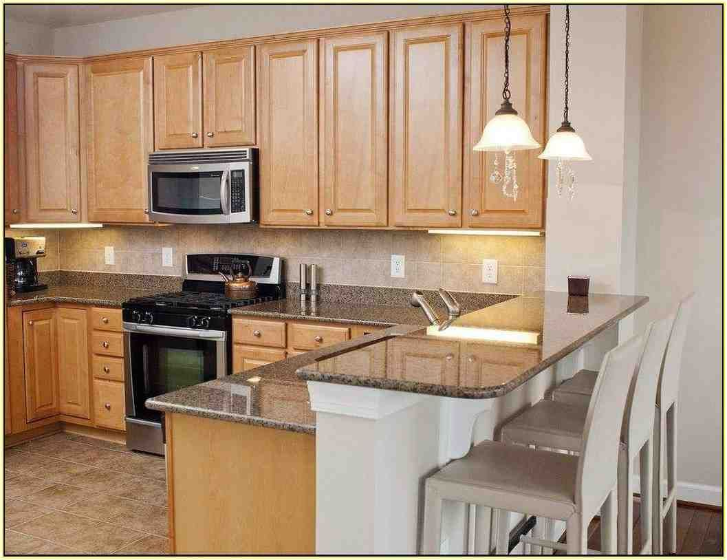 Granite Countertops with Maple Cabinets   Maple kitchen ... on Maple Cabinets White Countertops  id=20492