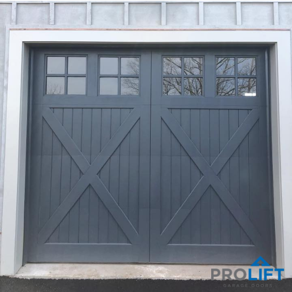 Custom Medallion Series Wooden Garage Doors Were Crafted From Red Grandis And Painted After The Door Insta Garage Doors Wooden Garage Doors Garage Door Styles