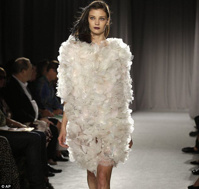 Ethereal: One look that caused a stir was an ivory silk chiffon cocktail dress, adorned with lace scallop and tiers of lace butterflies that...