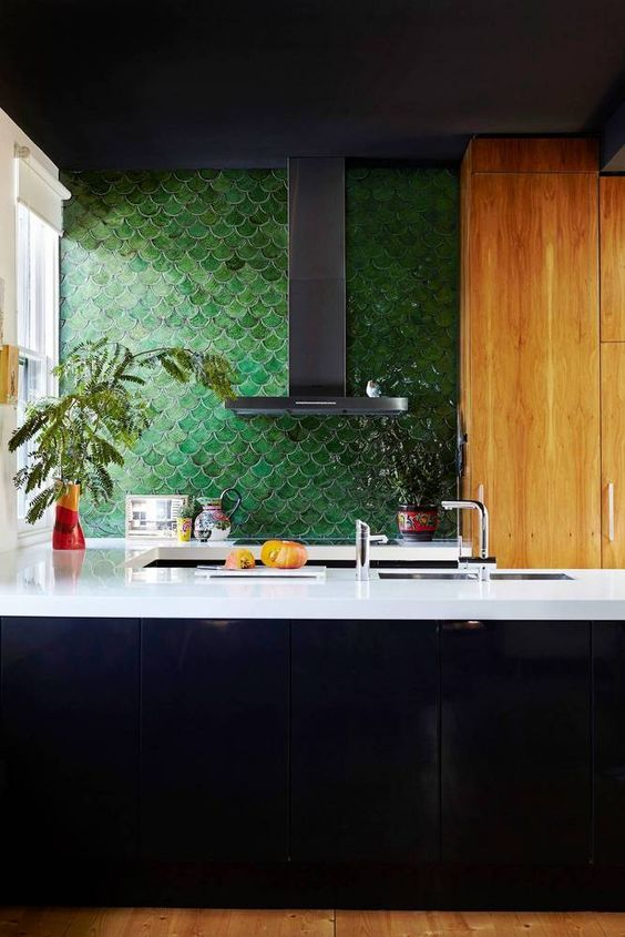 A Masculine Inspired Kitchen With Forest Green Fish Scale Tile And White Countertops
