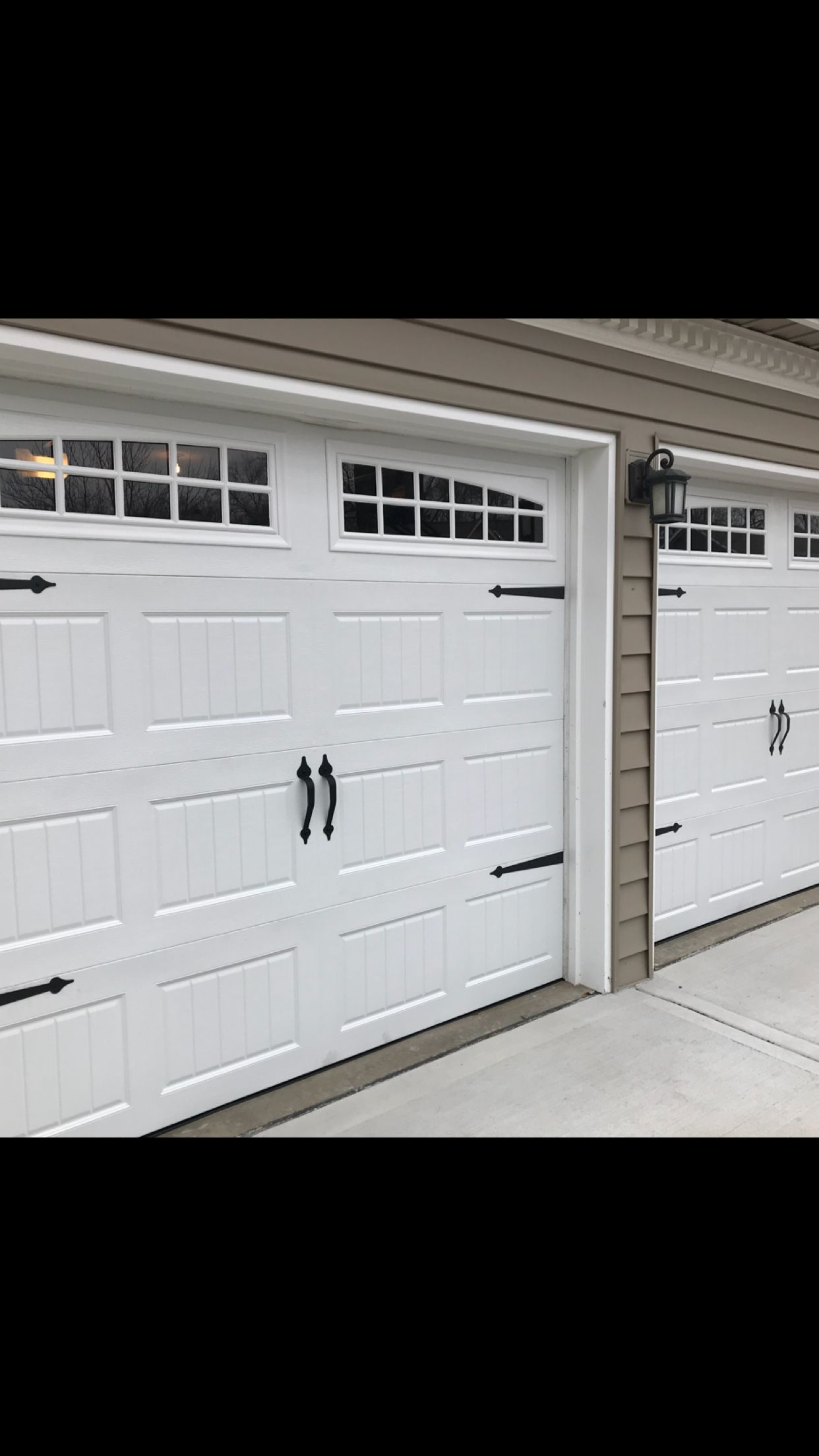 Beautiful White Carriage Style Garage Door With Decorative Hardware And Moonlite Long Carriage Style Garage Doors Garage Doors Garage Door Decorative Hardware