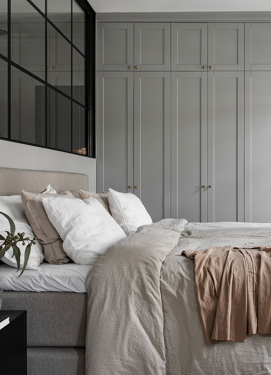 Simple Clean Grayscale Bedroom Paneled Grey Closets