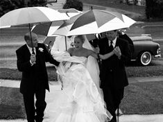 If it is going to rain, bring umbrellas! Artfully capture the authentic moments with Kurt Budliger Photography
