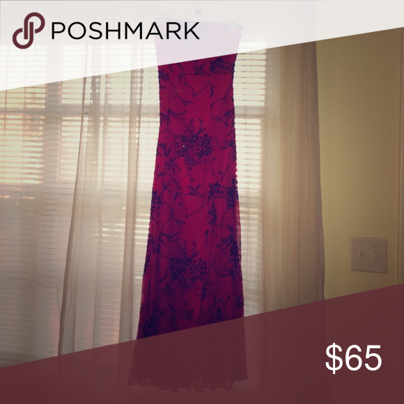 Red long dress with black beaded work This dress is perfect for a fancy event. It has mild padding in the busy, can be worn as a halter and has a small slit up the back. The beading is beautiful and is very secure. Sean Collection Dresses Prom