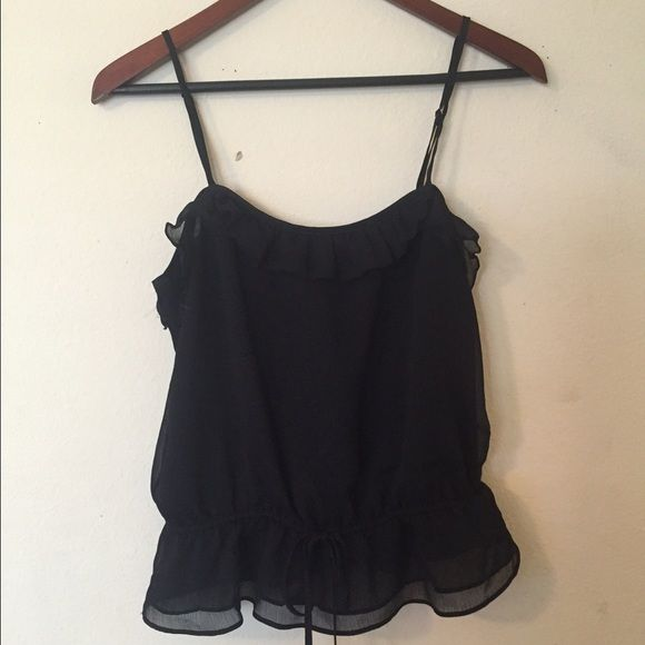Black Babydoll Top Ties at front. Never worn. Very cute.tagged Urban for views. Urban Outfitters Tops Blouses