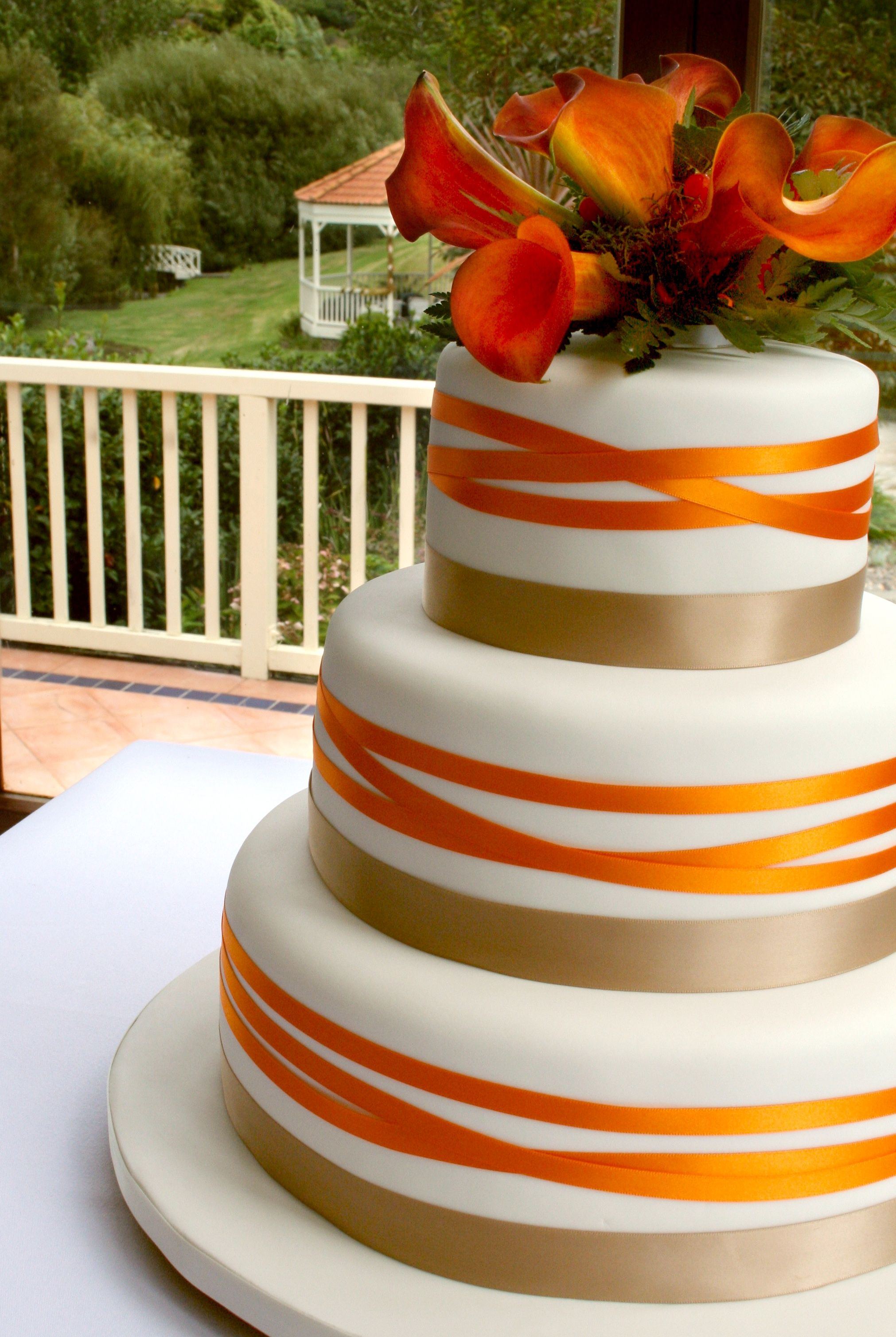 orange and white wedding cakes orange cake beautiful fresh flowers feature on this 18042